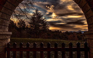 Preview wallpaper sunset, trees, fence, arch
